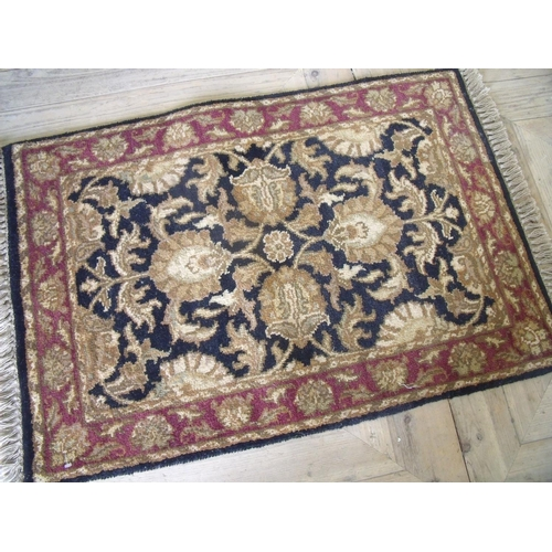 386 - Black & red ground Ziegler woollen rug (91cm x 61cm)...