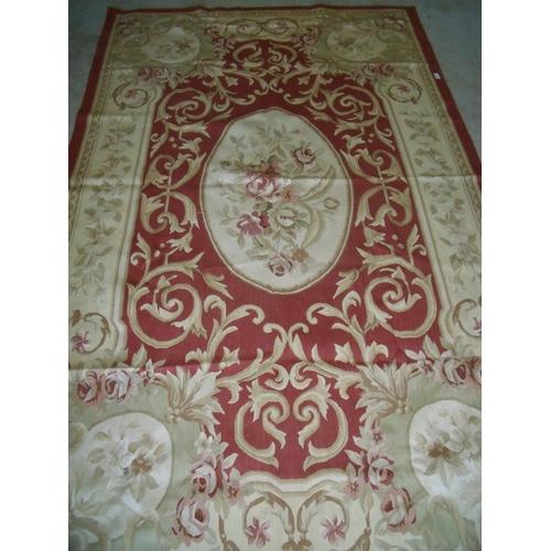 425 - Red & beige ground needle point rug (155cm x 249cm)...