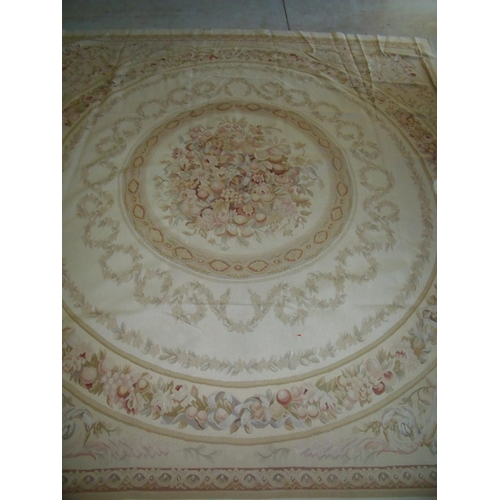 427 - Large beige ground needle point woollen carpet with central circular repeating pattern and floral pa...