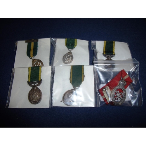 12 - Group of Territorial miniature medals including Territorial Force Nurse Service, GR V Officers, GR V...
