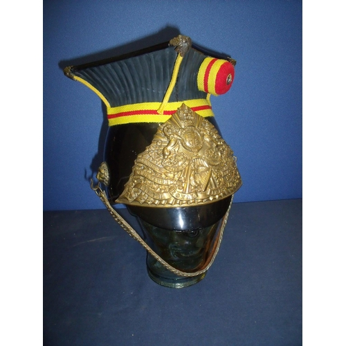 158 - A Lancers cap with square top and composite plastic body, complete with liner, with 5th Royal Irish ...