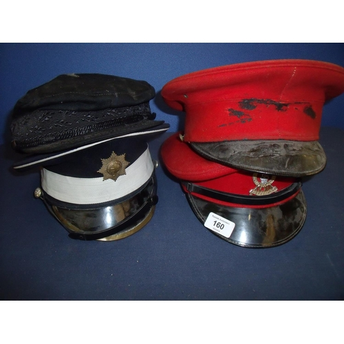 160 - Group of four military peaked caps including two scarlet cavalry caps,  Coldstream Guards and anothe...