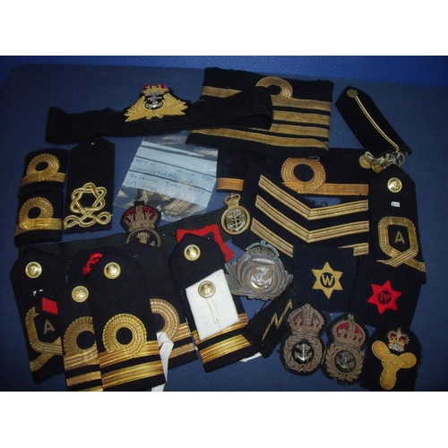 17 - Large collection of naval insignia, mostly embroidered cloth, including epaulettes, cap tallies, emb...
