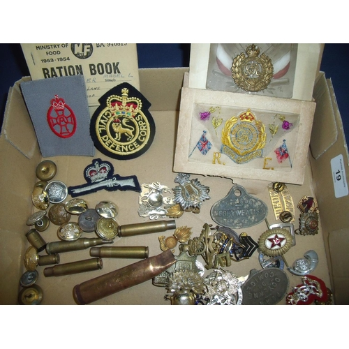 19 - Selection of various military cap badges, mostly British including stay bright, some cloth arm badge...