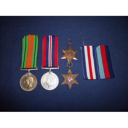 2 - Group of four WWII medals comprising of 39-45 Star, France & Germany Star, War & Defence Medals (4)...