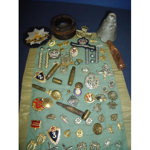 20 - Selection of various cap badges, a Civil Defence Corp lapel badge, inert ammunition, various Russian...