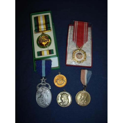 21 - Boxed ECOMOG Medal for Libya, various commemorative medals including a George V Queen Mary Coronatio...