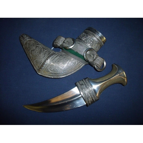 210 - 19th C Omani Jambiya with rhino horn hilt, the hilt and scabbard covered with fine silver decorated ...