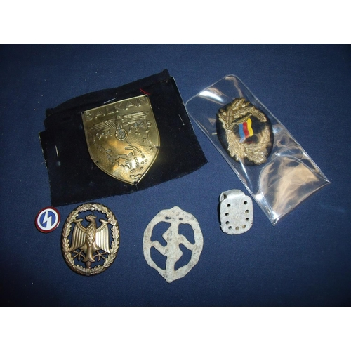 22 - Selection of WWII German related badges including relic state combat badge & lapel badge and possibl...