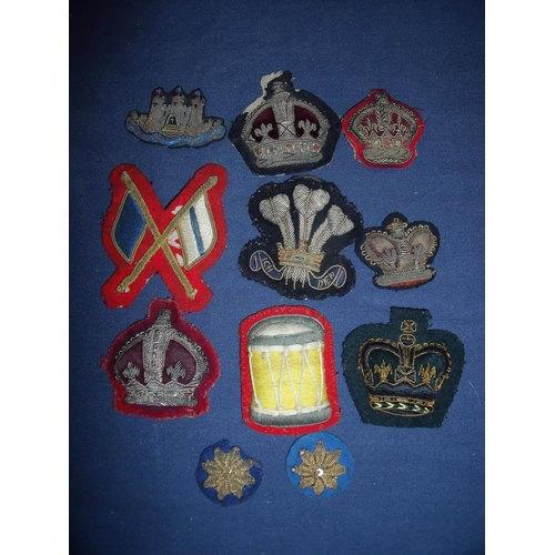 34 - Collection of various assorted embroidered and cloth badges and insignia including various crowns, P...