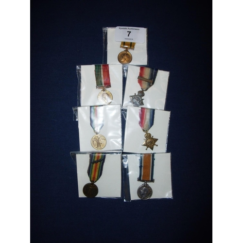 7 - Group of WWI miniatures including 1914 Star with clasp, another 1914 Star, War Medal, Victory medal ...