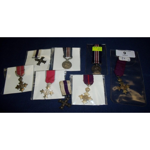 9 - Group of miniature medals including George V Medal, Military Cross with fastening clip for Spink & S...