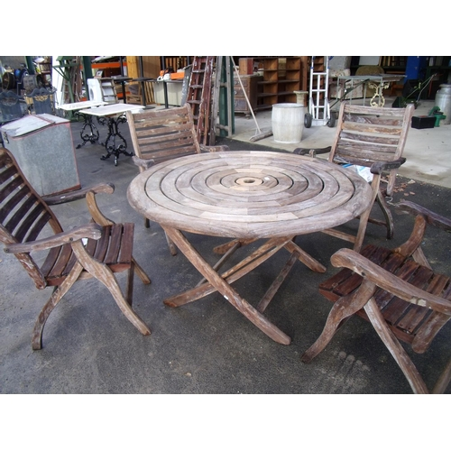 1 - Large circular wooden outdoor table and four chairs...