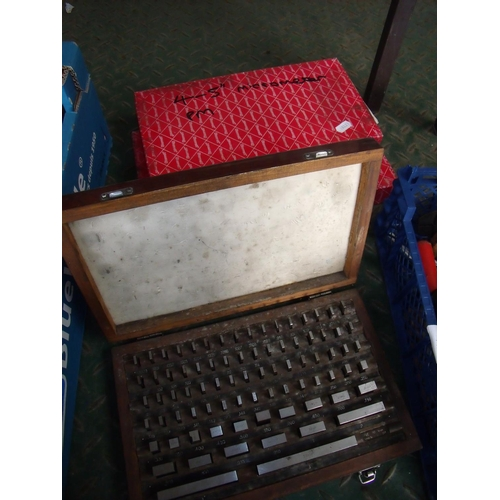 23 - Two boxed micrometres and a boxed gauge block set...