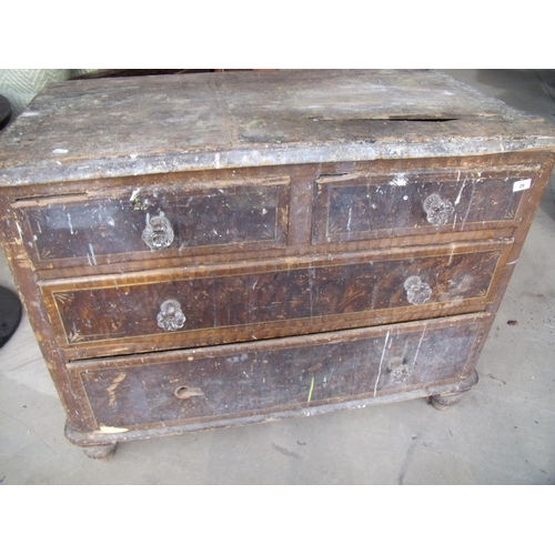 29 - Wooden chest of drawers with two short above two long suitable for a shed or garage...