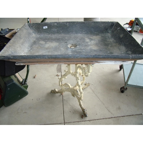 34 - Large wooden lead lined sink on a cast metal stand...