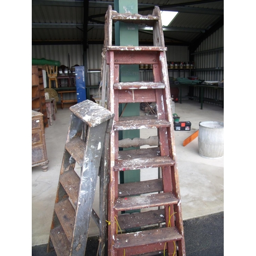 46 - Three wooden step ladders in varying conditions...