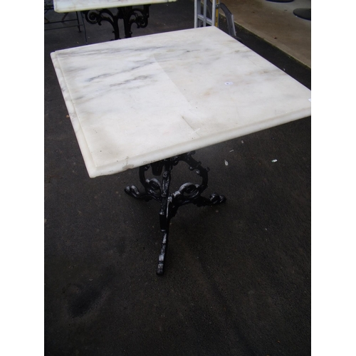 47 - Marble topped table on cast metal legs...