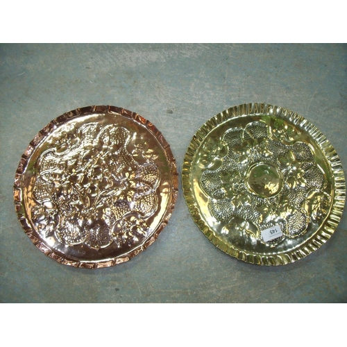 41 - Pair of early 20th C Arts & Crafts style circular chargers with embossed detail, one copper and one ...