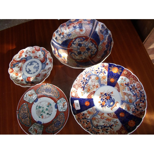 33 - Large Imari pattern charger, two shallow dishes and similar bowl (4)...