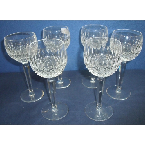 27 - Set of six Waterford Coleen design cut glass wine hock glasses, elaborately cut bowls on multifacete...