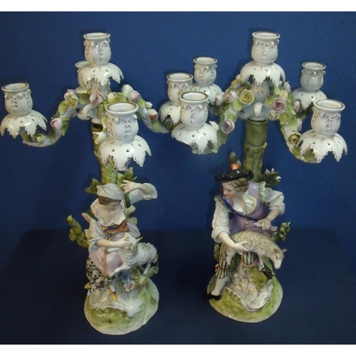 3 - Pair of 19th C continental ceramic four branch candelabra depicting couple holding lambs sat upon th...