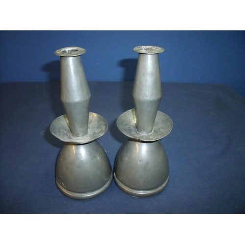 38 - Unusual pair of pewter candlesticks engraved with armorial crest, the under side market