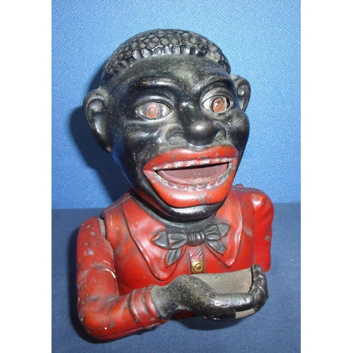 43 - 19th/20th C cast metal hand to mouth penny money bank (17cm high) named panel to back 'Jolly****** b...