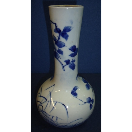 14 - Japanese blue & white bottleneck vase with nine digit signature panel to the base (28.5cm high)...