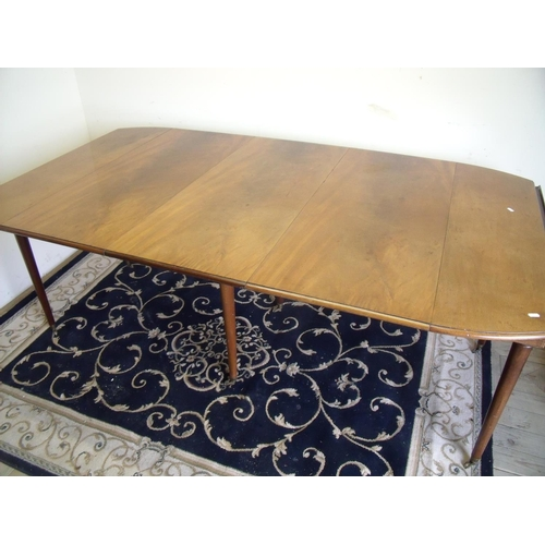 381 - Mahogany extending drop leaf dining table with three additional leaves with concertina scissor actio...