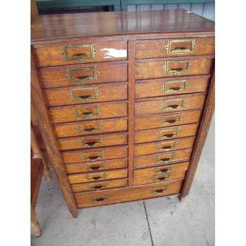 341 - Early - mid 20th C oak office filing type bank of drawers, with two folding flaps enclosing twenty s...