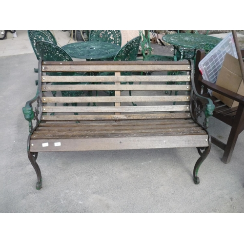 21 - Garden bench with green wrought iron ends...