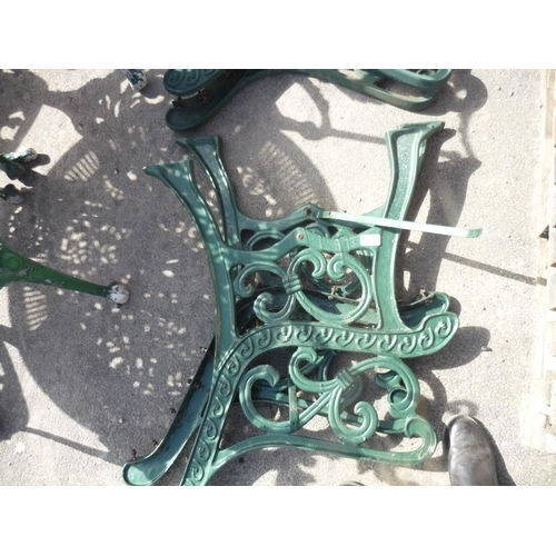 25 - Two wrought iron garden bench ends...