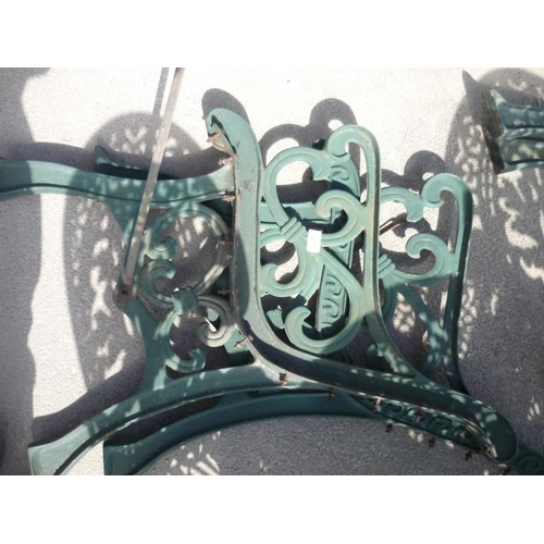 27 - Two wrought iron bench ends...