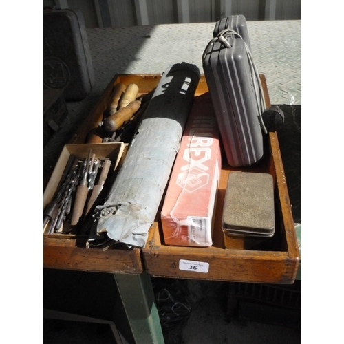 35 - Wooden box containing chisels and some drills, screwdrivers and welding rods...