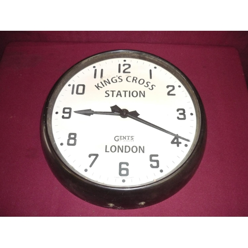 19 - Gents of Leicester electric wall clock, the dial marked Kings Cross Station London in Bakelite style...