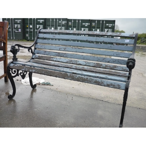1 - Garden bench with wrought iron ends with lions on the handles...