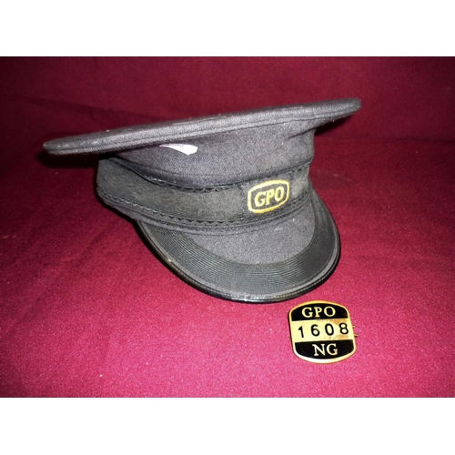 89 - GPO peaked cap and brass & enamel GPO NG badge. No 1608 (2)...