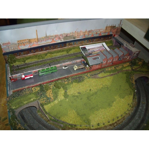 111 - N gauge model railway layout with track scenery, buildings and accessories...