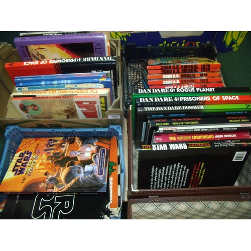 117 - Large collection of books, annuals etc in four boxes including Dan Dare 2000AD, science fiction art,...