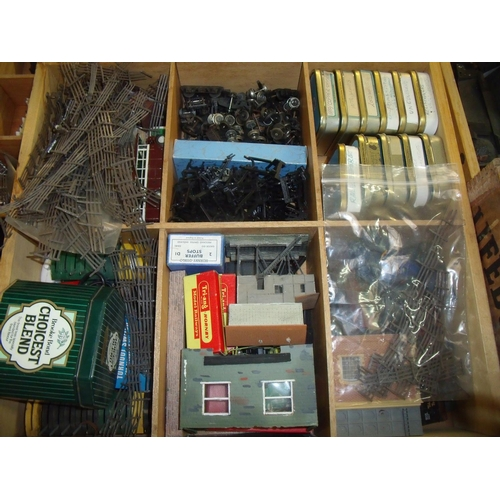 151 - Multi-sectional drawer containing a large quantity of OO gauge railway accessories including control...