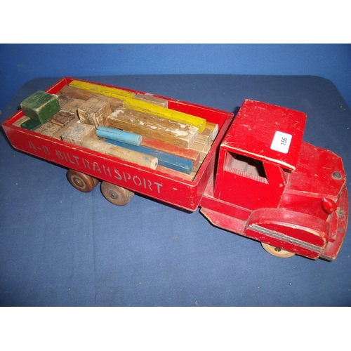 156 - Wooden constructed toy flatbed truck with various accessories marked A-B Bil Transport...