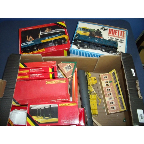 169 - Quantity of boxed OO gauge train accessories, mostly Hornby, including buildings, platform canopy, D...