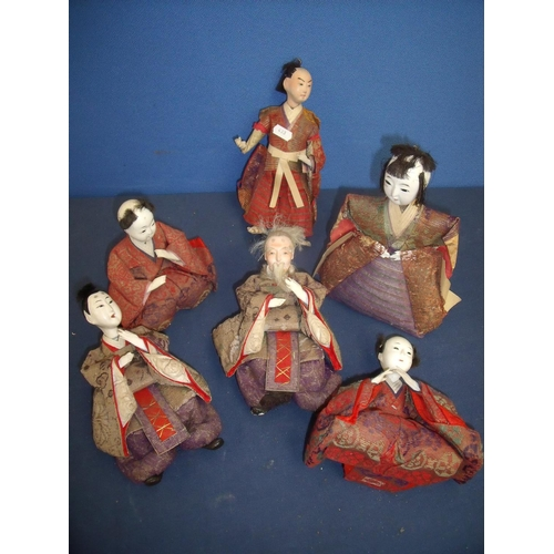 175 - Collection of six Japanese dolls depicting various figures in seated and standing positions with ass...