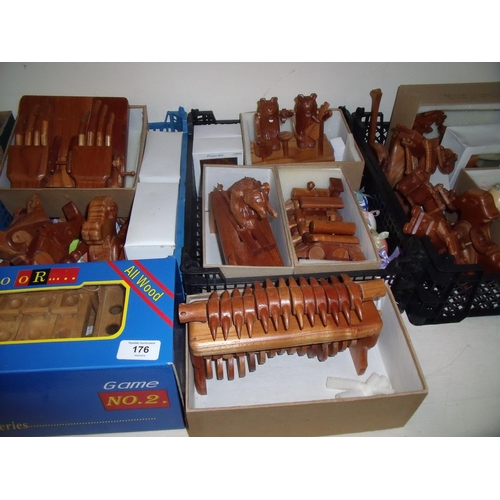 176 - Large quantity of carved wood toys and figures including Easter Eggs, bears, trains etc, most with m...