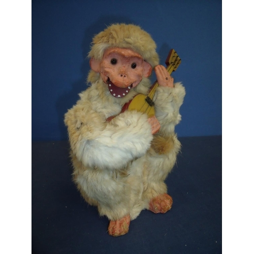 192 - French 19th/20th C Roullet and Decamps clockwork automaton, papier-mache and animal fur monkey (heig...