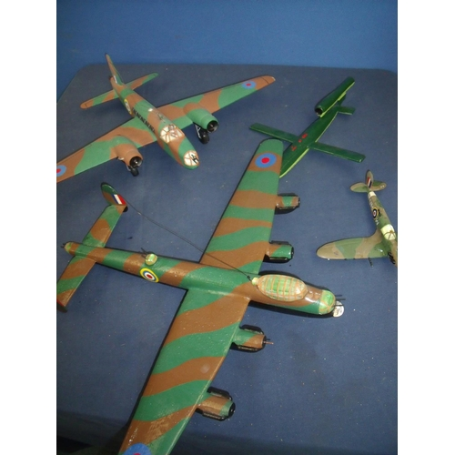 194 - Four wooden models of aircraft including a Lancaster, Wellington, Spitfire and a V1 flying bomb....