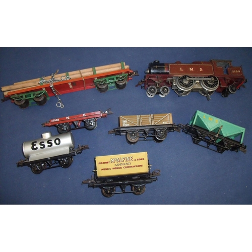 216 - Hornby O gauge 20v electric locomotive LMS No 2180 with six various Hornby O gauge rolling stock...