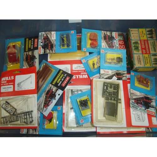 231 - Quantity of boxed OO gauge railway accessories including various Merit kits...