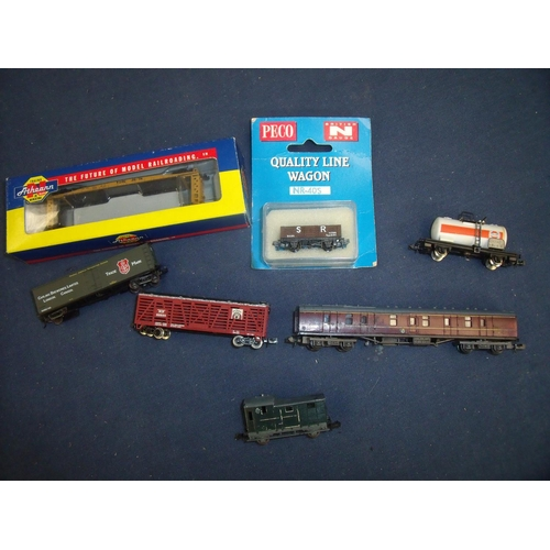 248 - Selection of N gauge model railway including boxed bulkhead flat truck, a box wagon, various other r...